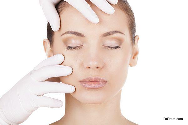 Preparation before facial surgery. Beautiful young woman keeping
