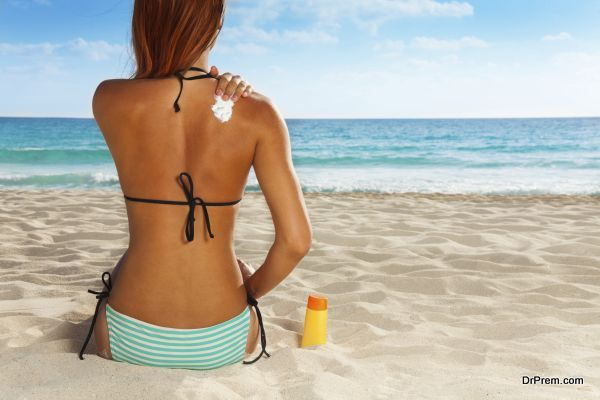 Ð¡ute girl's back with sunscreen on it