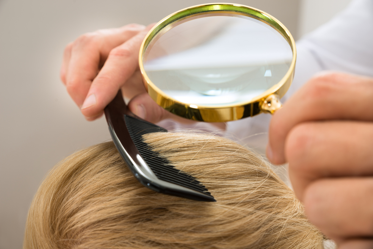 Dermatologist Looking Blonde Hair Through Magnifying Glass